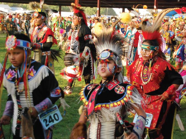 Dancers of all ages with individualized regalia participate in the grand entry at the Shoshone-Bannock Festival, one of the most popular events on the summer powwow circuit. Photo courtesy of Shoshone-Bannock Tribes Office of Public Affairs