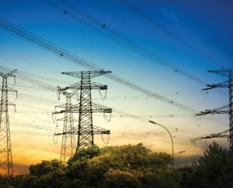 Photo of power lines with dusk in the background