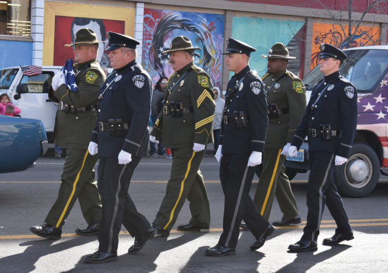Veterans representing all branches of military service and law enforcement participate in the parade.