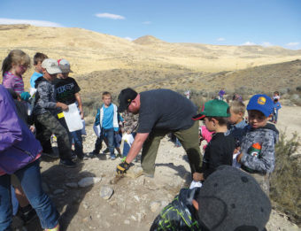 A geologist encourages students to dig in and discover what lies beneath their feet