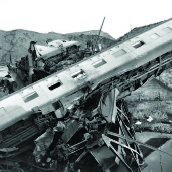 Old photo of a train car sprawled among wreckage