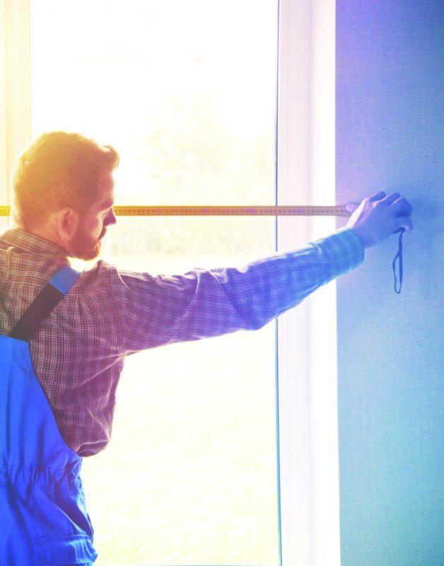 Man taking measurements