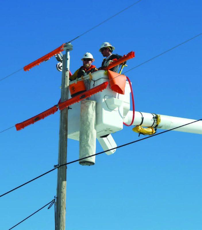 Linemen working on power line