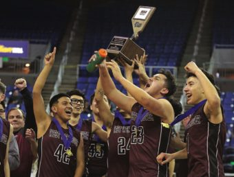 The West Wendover Wolverines celebrate their victory in the Nevada Interscholastic Activities Association Division 2A championship.