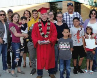 Howie's extended biological family and the Collinses celebrate his 2018 graduation from Carlin High School.