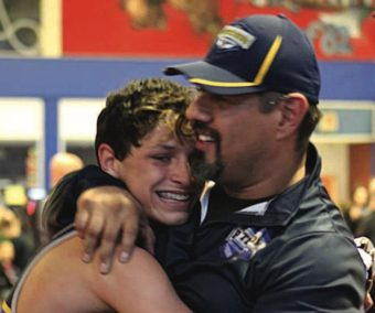 Druzton celebrates with his coach after winning the 2018 USA Wrestling Nevada state championship title.