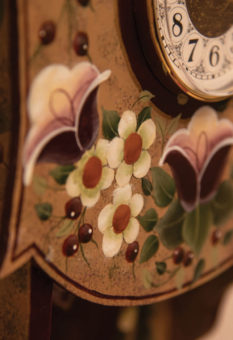 Tole painted wood around clock