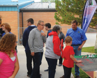WREC employee Thad Ballard talks with members at a Carlin Community Rally in the past.