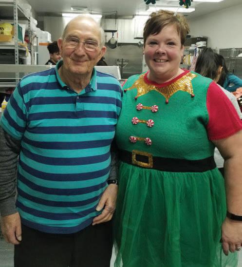 Frank Sharp and Brenda (wearing a holiday helper costume)