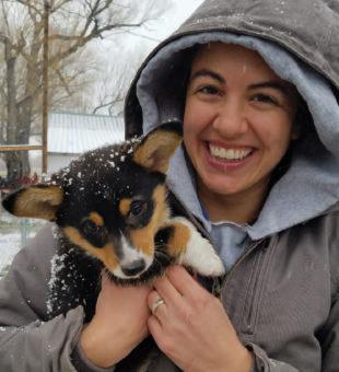 Hannah holding a dog.