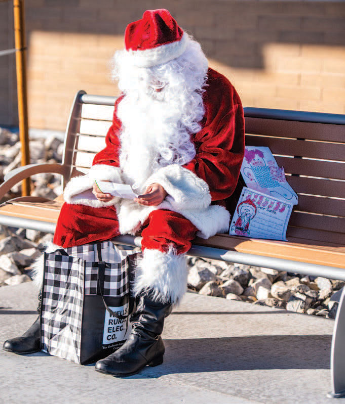 santa with presents sitting on bench