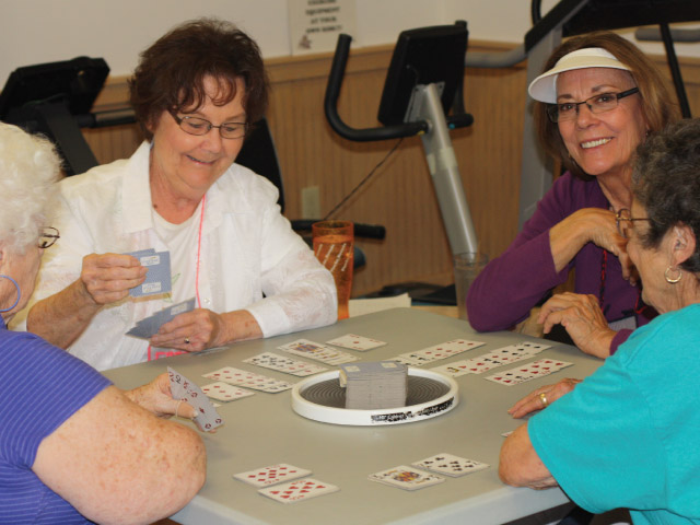 Carlin Open Door Senior Center clients can always find someone to play cards or other games. Photos by Lonnie Brown