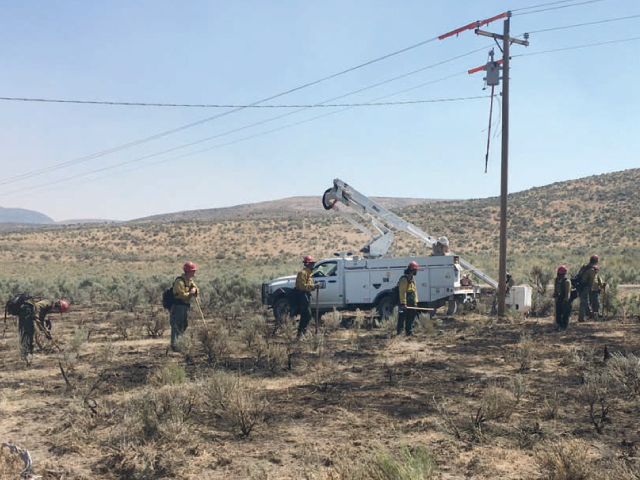 Wells Rural Electric Co. line crews are trained and prepared to handle fire-related situations that endanger utility buildings, equipment and personnel.
